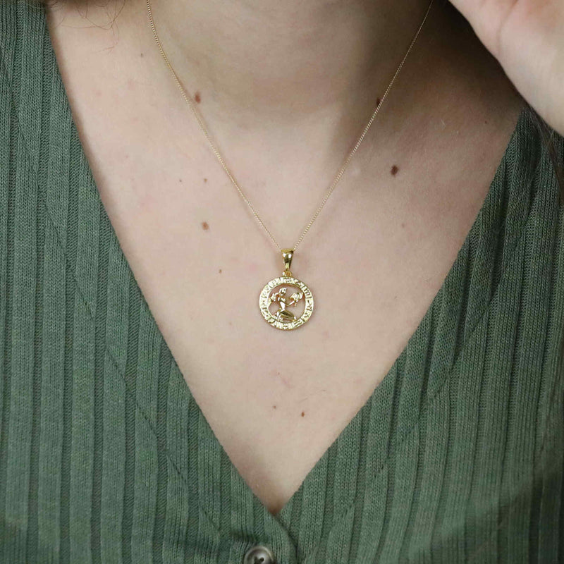 Model Wearing Beautiful Zodiac Aquarius Solid Gold Pendant By Jewelry Lane