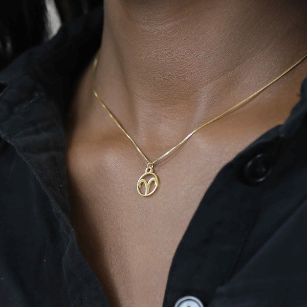 Model Wearing Charming Zodiac Aries Minimalist Solid Gold Pendant By Jewelry Lane