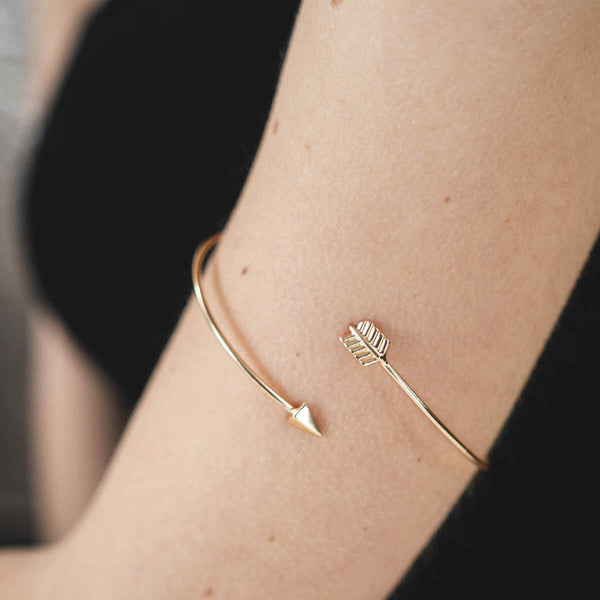 Model Wearing Beautiful Adjustable Arrow Style Solid Gold Armband Bangle By Jewelry Lane