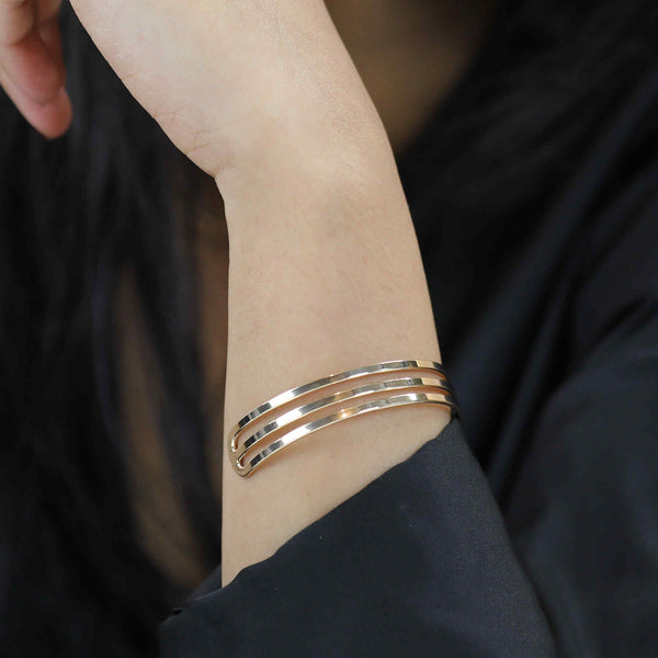 Model Wearing Three Ring Solid Gold Cuff Bangle by Jewelry Lane