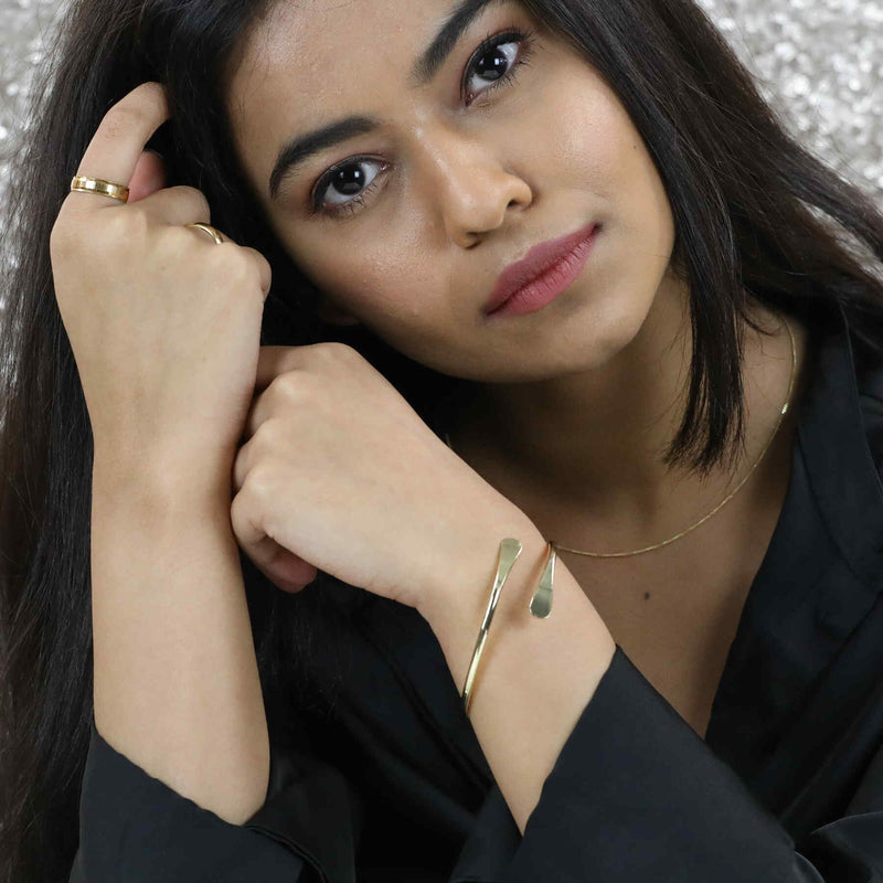 Model Wearing Solid Gold Open Cuff Bangle by Jewelry Lane