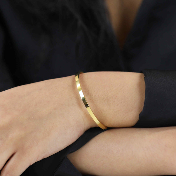 Model Wearing Beautiful Timeless Solid Gold Open Cuff Bangle by Jewelry Lane