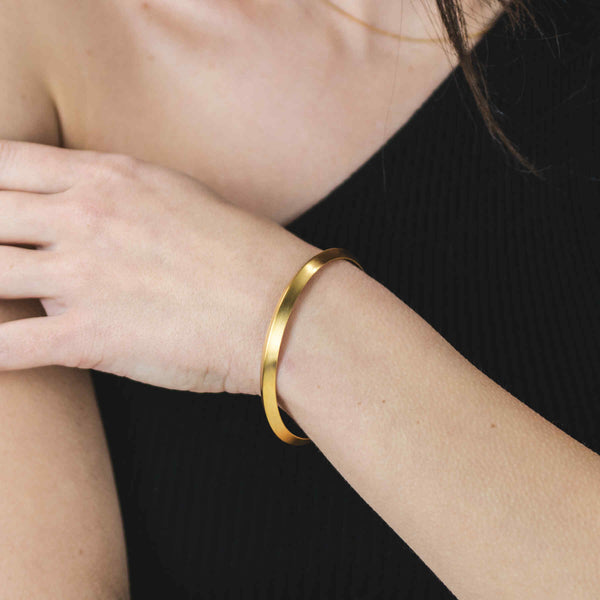 Model Wearing Beautiful Executive Modern Cuff Solid Gold Bangle By Jewelry Lane