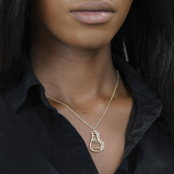 Model Wearing Unique Modern Science Beaker Style Solid Gold Pendant By Jewelry Lane