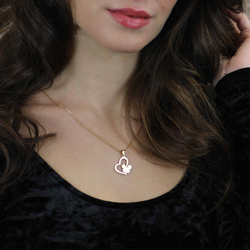 Model Wearing Exquisite Irish Love Butterfly Tilted Heart Solid Gold Pendant By Jewelry Lane