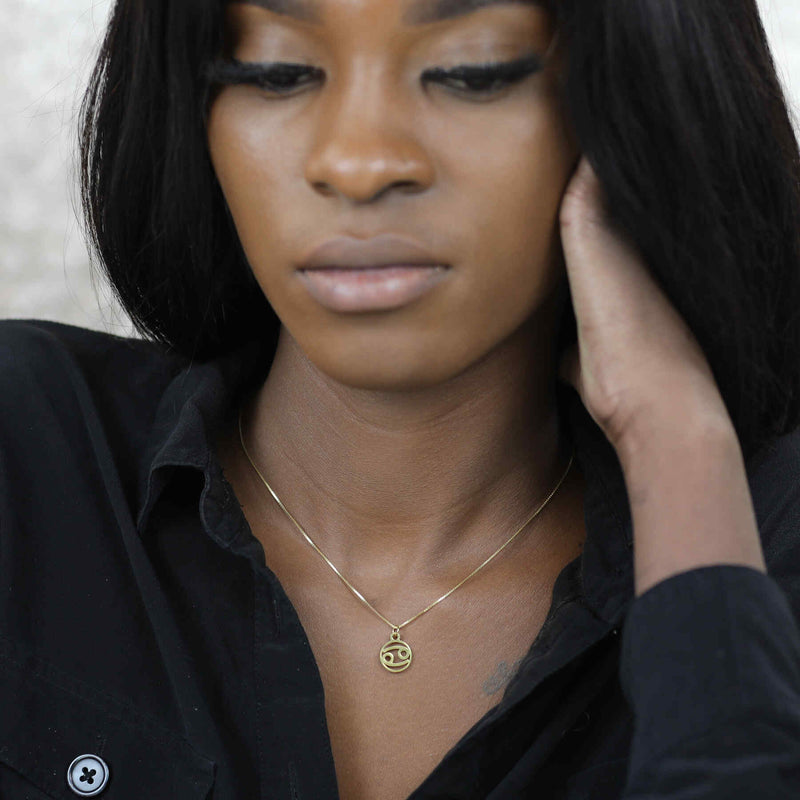 Model Wearing Charming Zodiac Cancer Minimalist Solid Gold Pendant By Jewelry Lane