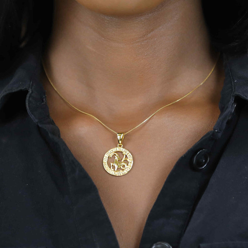 Model Wearing Beautiful Zodiac Capricorn Solid Gold Pendant By Jewelry Lane