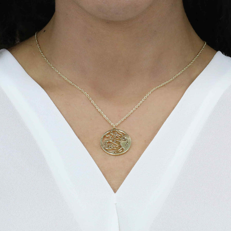 Model Wearing Beautiful Celestial Sun Moon Star Solid Gold Necklace By Jewelry Lane
