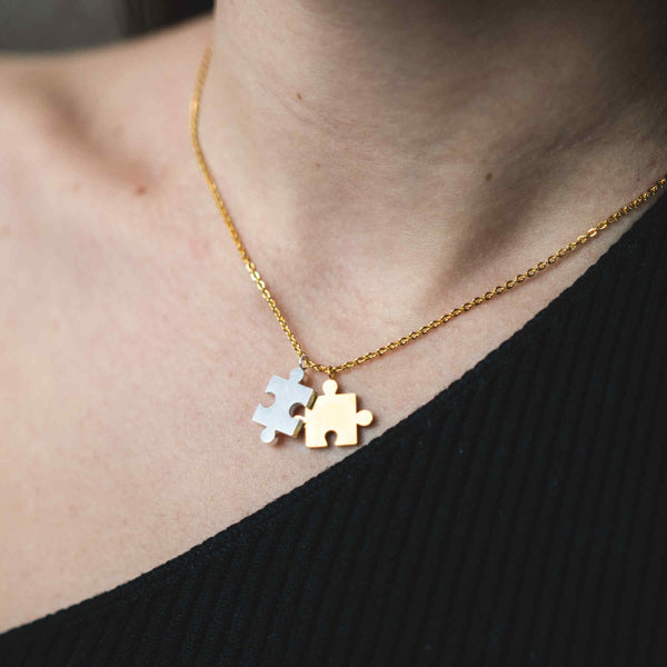 Model Wearing Beautiful Modern Two Tone Puzzle Design Solid Gold Necklace By Jewelry Lane