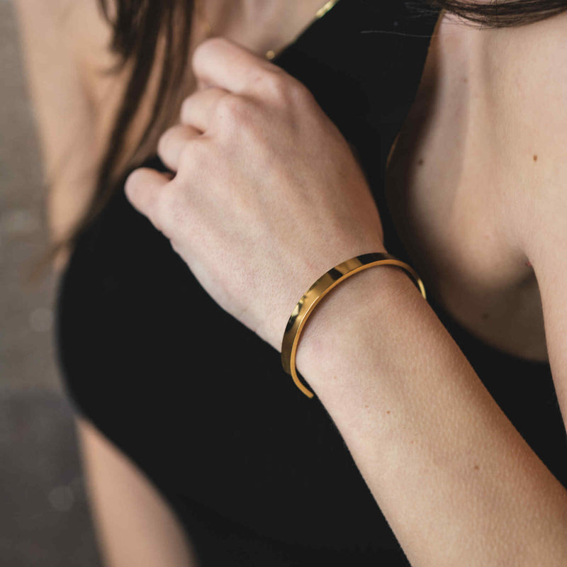 Model Wearing Beautiful Solid Gold Open Cuff Bangle by Jewelry Lane