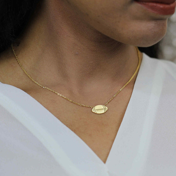 Model Wearing Beautiful Unique Football Solid Gold Pendant By Jewelry Lane