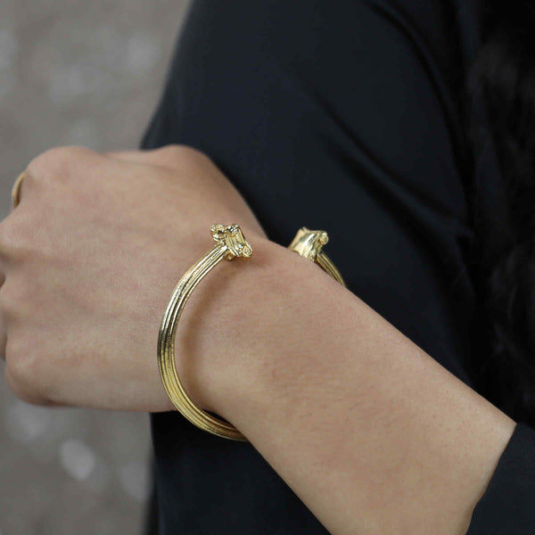 Model Wearing Beautiful Solid Gold Greek Column Bangle by Jewelry Lane