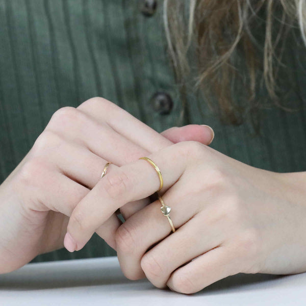 Model Wearing Beautiful Simple Heart Stacker Solid Gold Ring By Jewelry Lane