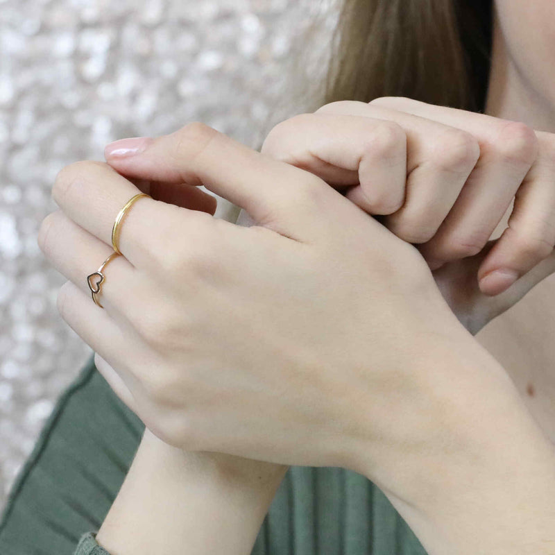 Model Wearing Beautiful Simple Open Heart Love Stacker Solid Gold Ring By Jewelry Lane
