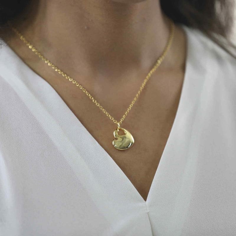 Model Wearing Beautiful Charming Heart Shaped Solid Gold Pendant By Jewelry Lane