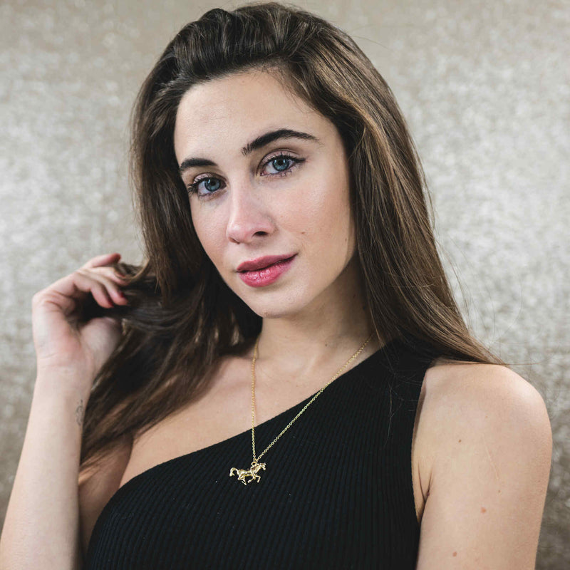 Model Wearing Elegant Beautiful Horse Design Solid Gold Pendant By Jewelry Lane