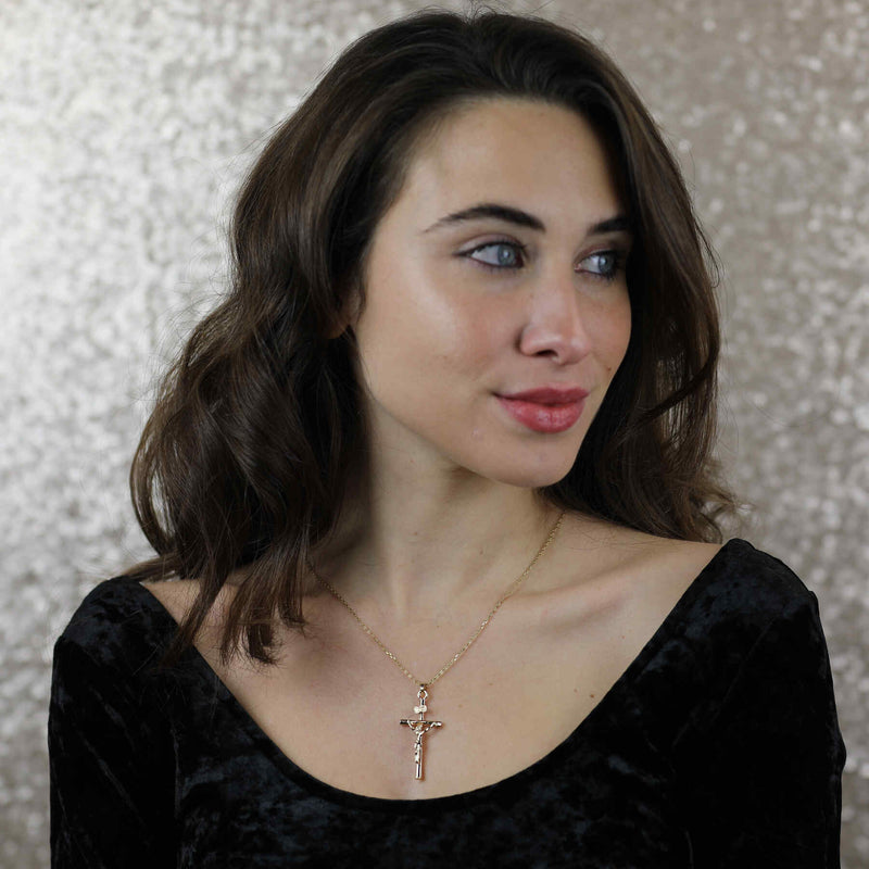 Model Wearing Beautiful Religious Jesus Cross Solid Gold Pendant By Jewelry Lane