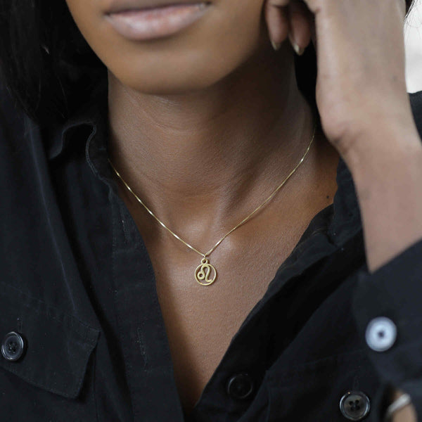 Model Wearing Charming Zodiac Leo Minimalist Solid Gold Pendant By Jewelry Lane