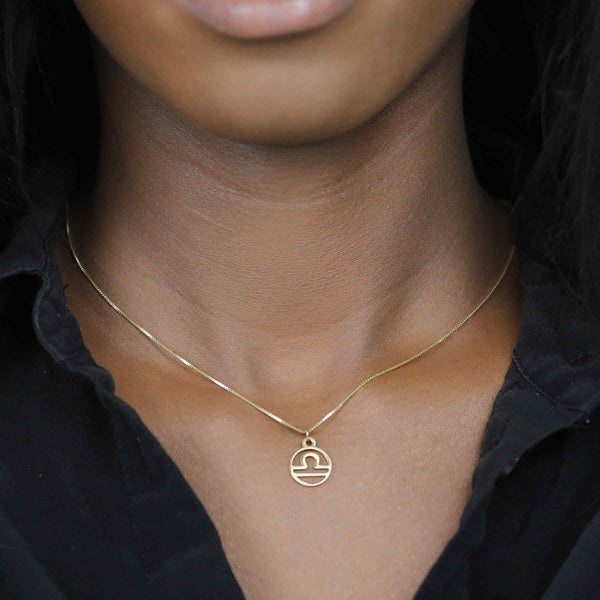 Model Wearing Charming Zodiac Libra Minimalist Solid Gold Pendant By Jewelry Lane