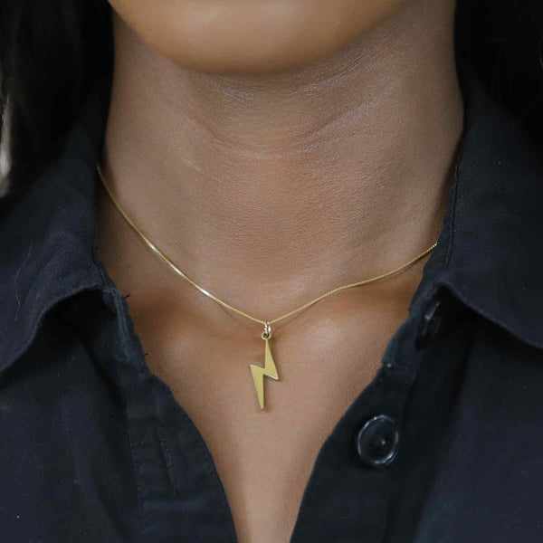 Model Wearing Beautiful Handcrafted Lightning Bolt Solid Gold Necklace By Jewelry Lane