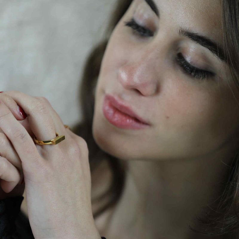Italian model wearing Beautiful Solid Gold Minimalist Stacker Ring by Jewelry Lane
