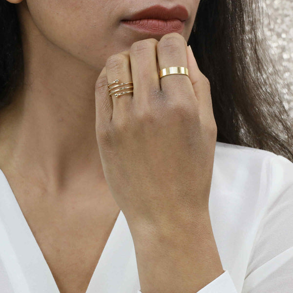 Model Wearing Elegant Simple Spiral Solid Gold Ring By Jewelry Lane