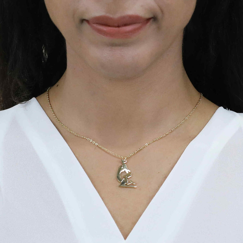 Model Wearing Elegant Unique Microscope Design Solid Gold Pendant By Jewelry Lane