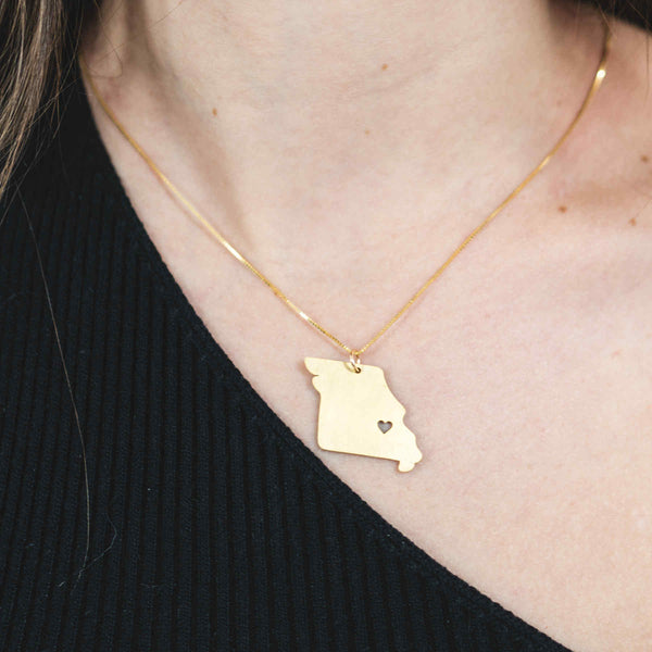 Model Wearing Elegant Unique Missouri State Design Solid Gold Pendant By Jewelry Lane