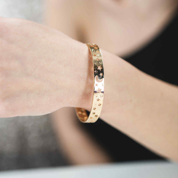 Model Wearing Beautiful Gorgeous Intricately Cut Moon Star Solid Gold Bangle By Jewelry Lane