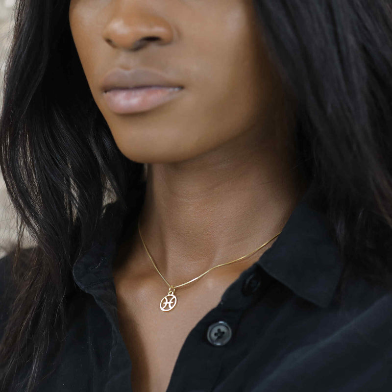 Model Wearing Charming Zodiac Pisces Minimalist Solid Gold Pendant By Jewelry Lane
