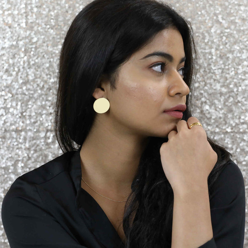 Model Wearing Solid Round Circle Gold Earrings by Jewelry Lane