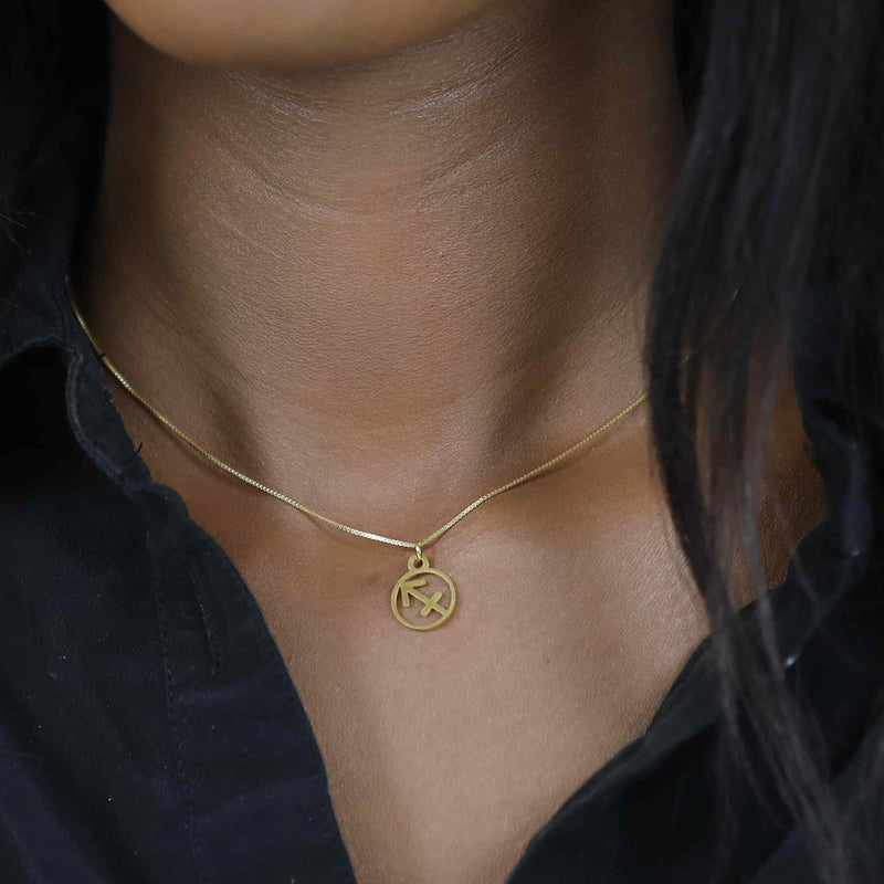 Model Wearing Charming Zodiac Sagittarius Minimalist Solid Gold Pendant By Jewelry Lane