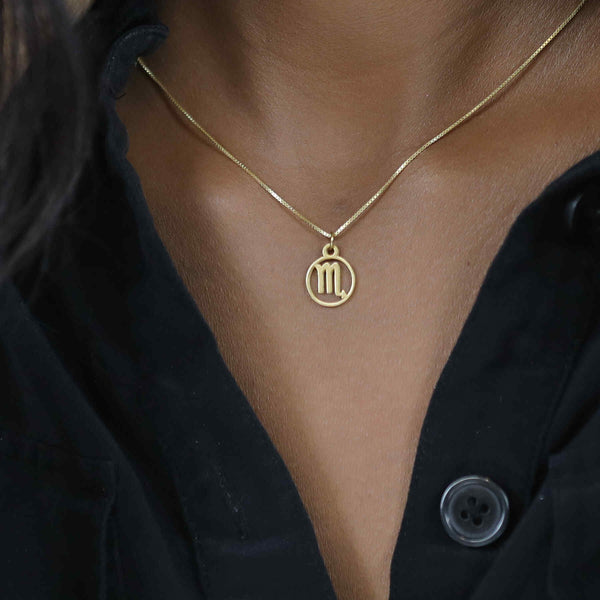 Model Wearing Charming Zodiac Scorpio Minimalist Solid Gold Pendant By Jewelry Lane