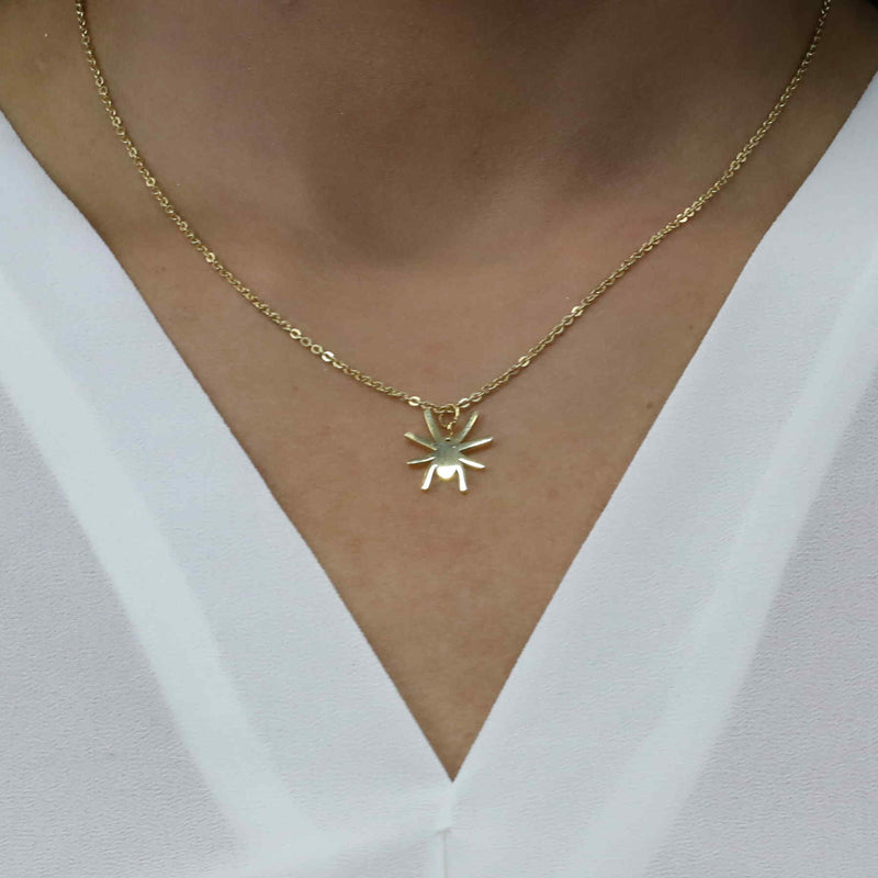 Model Wearing Beautiful Unique Spider Shape Solid Gold Pendant By Jewelry Lane