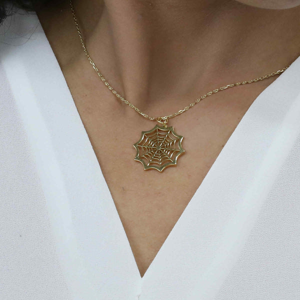 Model Wearing Beautiful Modern Spider Web Solid Gold Pendant By Jewelry Lane