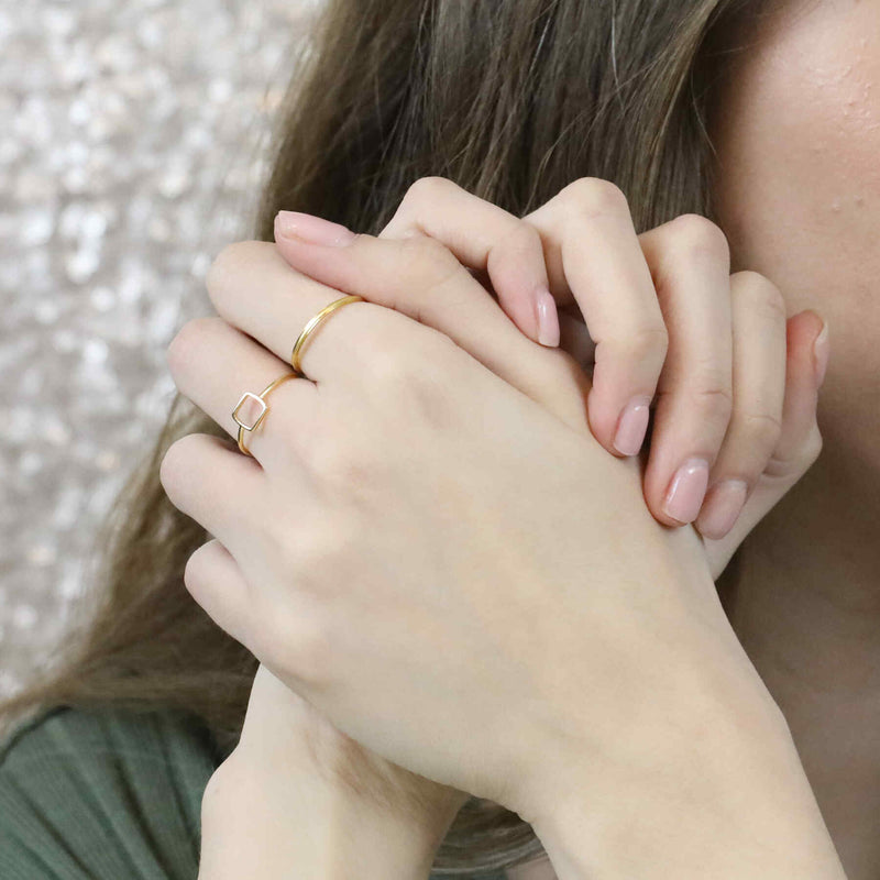 Model Wearing Simple Elegant Square Stacker Solid Gold Ring By Jewelry Lane