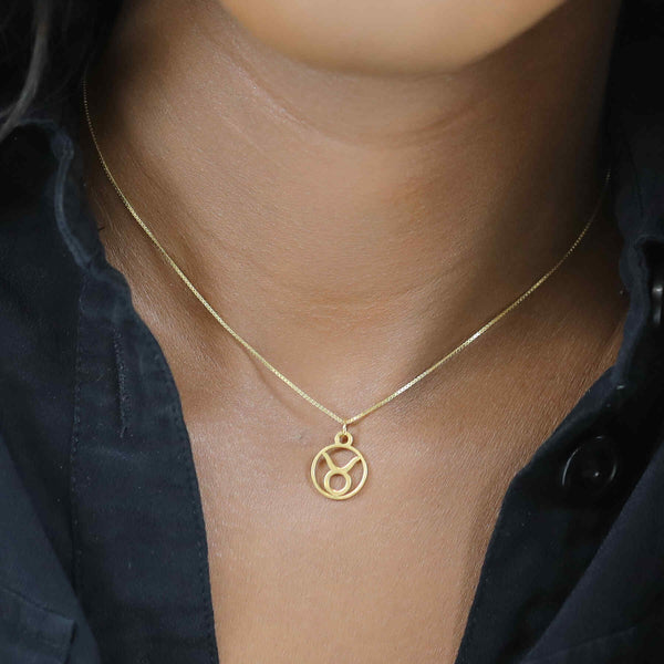 Model Wearing Charming Zodiac Taurus Minimalist Solid Gold Pendant By Jewelry Lane