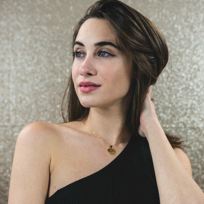 Italian Model Wearing Beautiful Simple Expressive Te Amo Mama Solid Gold Pendant By Jewelry Lane