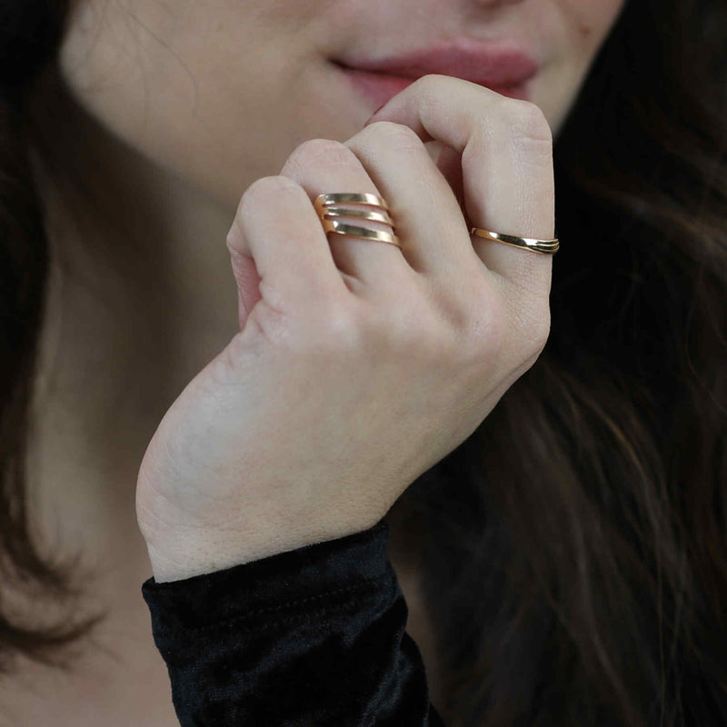 Model Wearing Beautiful Triple Flat Flared Solid Gold Ring By Jewelry Lane
