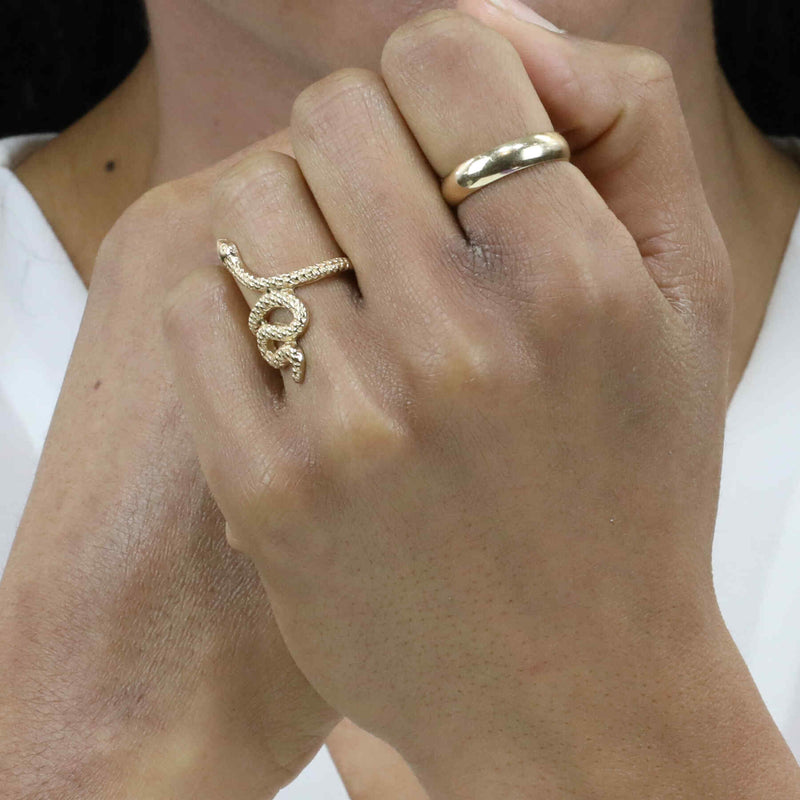 Model Wearing Charming Unique Snake Design Solid Gold Ring By Jewelry Lane