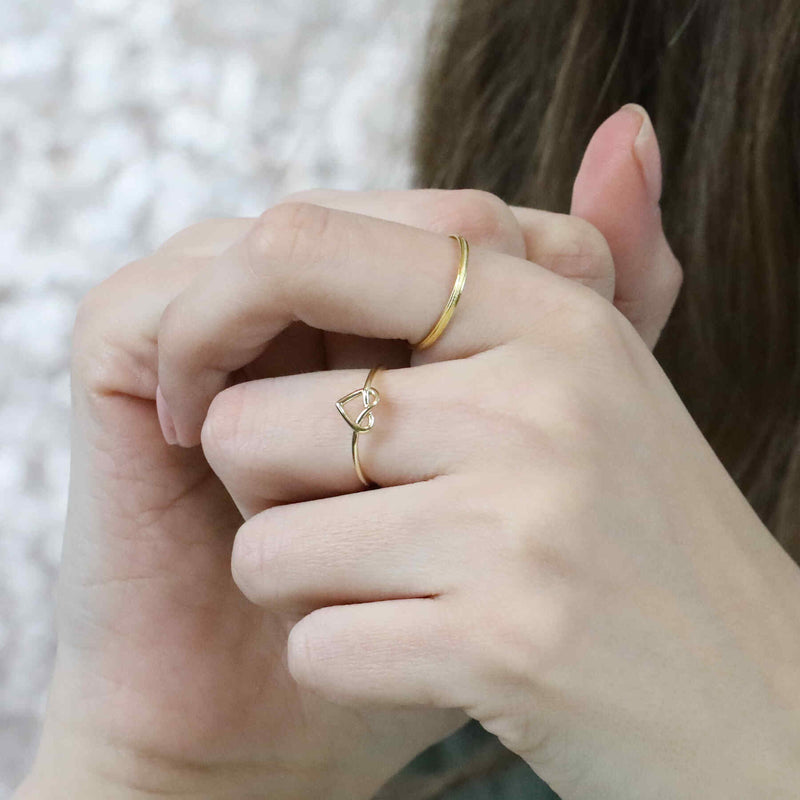 Model Wearing Beautiful Wire Style Heart Stracker Solid Gold Ring By Jewelry Lane