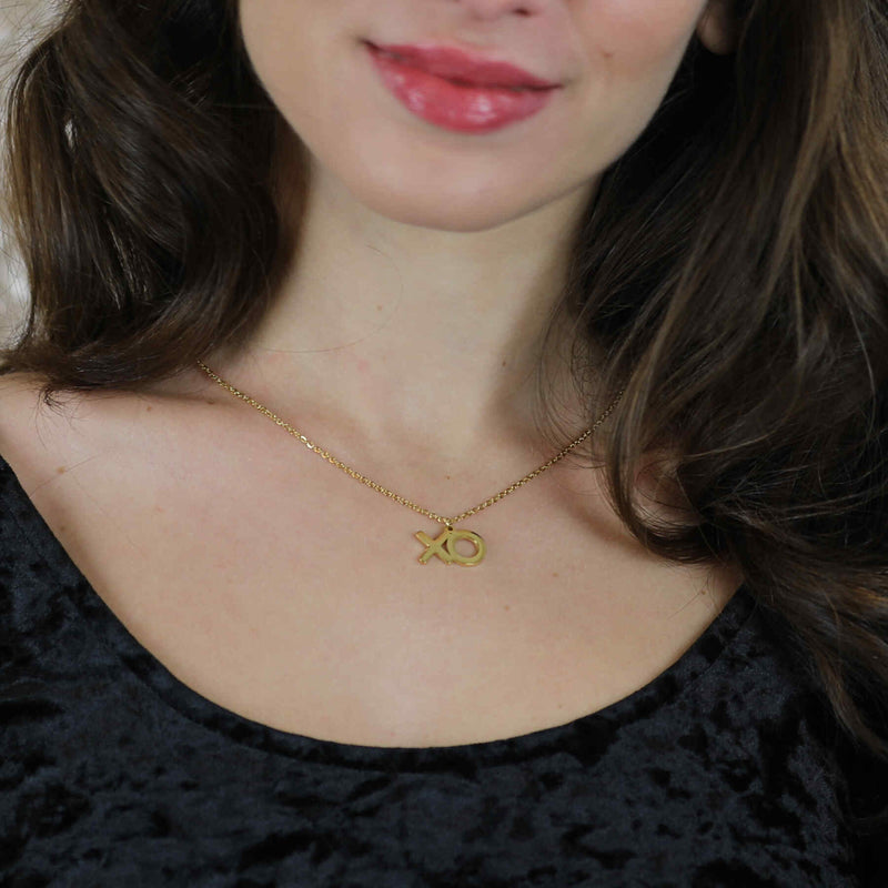 Model Wearing Beautiful XO Hugs And Kisses Solid Gold Pendant By Jewelry Lane