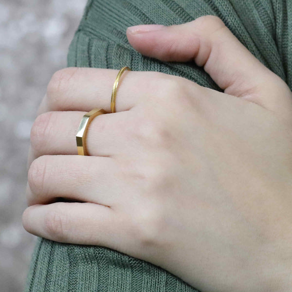 Model Wearing Beautiful Unique Modern Bolt Design Solid Gold Ring By Jewelry Lane