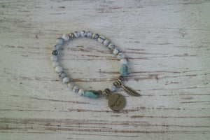 White Howlite beaded bracelet with Larimar nugget beads and a silver 'mermaid soul' and boho feather charm
