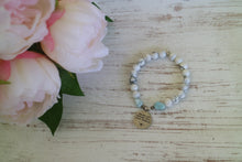 Load image into Gallery viewer, White howlite and Larimar nugget beaded bracelet with silver 'never let anyone dull your sparkle' charm