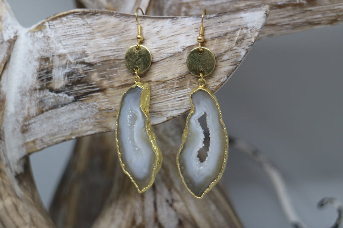 White goede druzy agate earrings with gold plated edges, and 24k gold plated charms