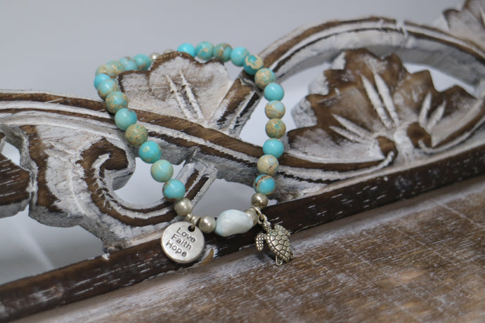 Blue Sea Sediment Jasper gemstone beads with Larimar nugget bead and silver 'love faith hope' and turtle charms