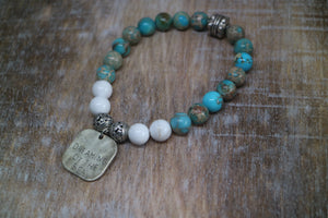 Blue Sea Sediment Jasper and white howlite gemstone beaded bracelet with rustic silver 'dreaming of the sea' charm