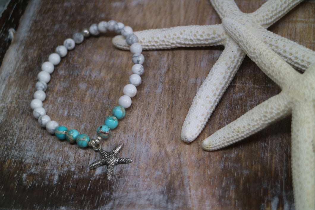 White howlite and blue sea sediment jasper gemstone beaded bracelet with silver starfish charm