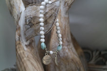 Load image into Gallery viewer, White Howlite beaded bracelet with Larimar nugget beads and a silver 'mermaid soul' and boho feather charm